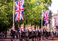 British men on horses with flags